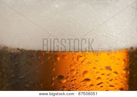 Big Glass With Handle Filled With Fresh Beer With A Lot Of Foam On Top On Brown Background