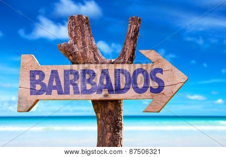 Barbados wooden sign with beach background