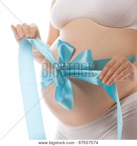 pregnant caucasian woman closeup body isolated on white background studio shot belly blue
