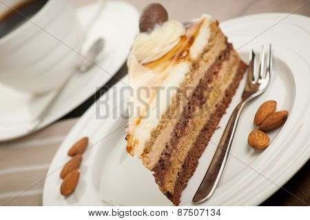 Deliceous Slice Og Caramel Mousse Cake On A Plate  For Breakfast Closeup Photo With Cup Of Coffee In