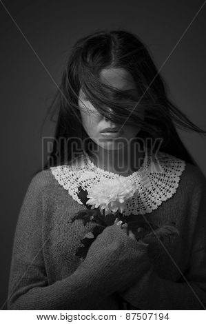 Young Brunette Woman With White Chrysanthemum Portrait. Dark Colors.