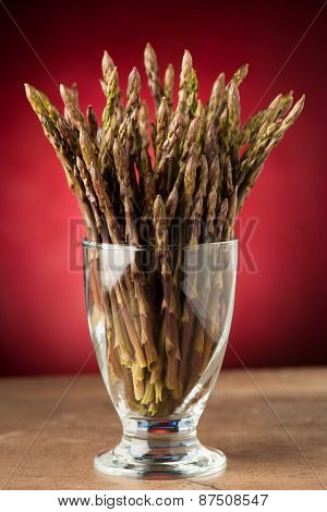 Fresh Wild Asparagus In A Glass Ready To Be Cooked