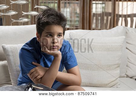 Little boy thinking while looking at space for your text