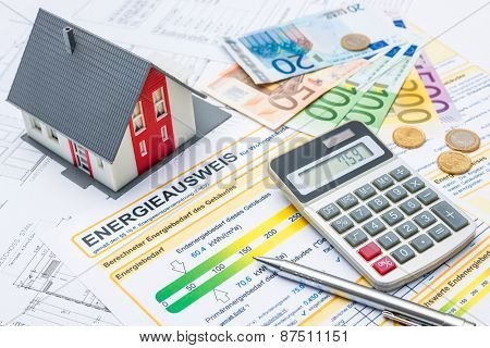 House with money, calculator and an energy efficiency certificate