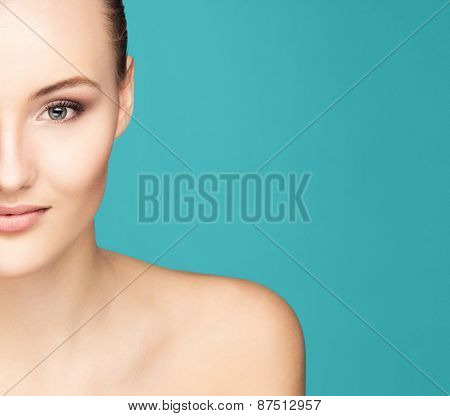 Portrait of a young woman over green background
