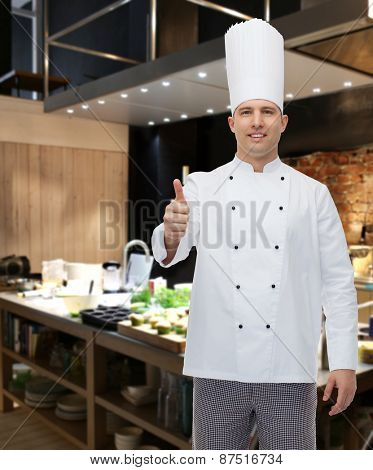 cooking, profession, gesture and people concept - happy male chef cook showing thumbs up over restaurant kitchen