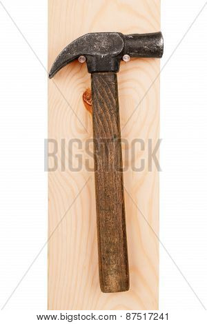 Hammer On A Wooden Board