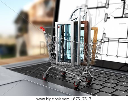 The Windows In The Shopping Cart On Notebook Keyboard. E-commerce. Concept Of Warm House.
