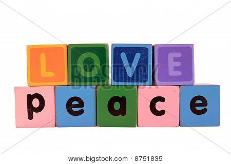 Love On Peace In Wood Play Block Letters Against White