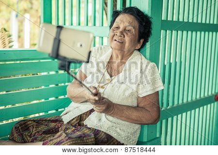 Happy Senior Woman Posing For A Selfie