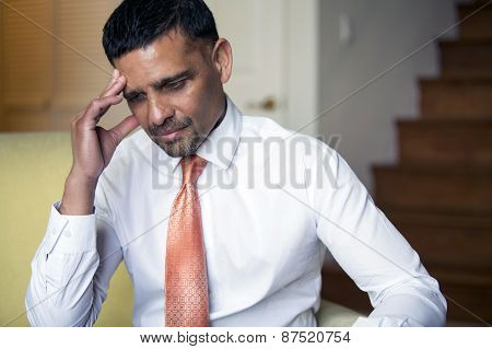 Portrait Of A Businessman Looking Thoughtful