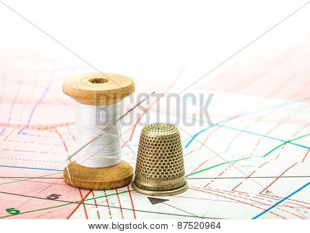 Sewing Thread And Thimble On Pattern Cutting