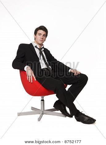 Men in red armchair