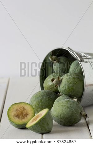 Feijoas in a Bucket with One Cut