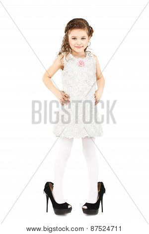 Little Girl Dressed Great Mother's Shoes Isolated On White Background