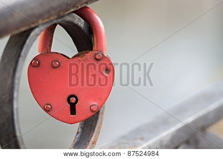 Big Padlock Of Red Color On Fence