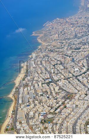 TEL AVIV, ISRAEL - MARCH 21, 2014: Aerial view of Mediterranean coastline and cityscape. With 14 kilometres of beach and 300 days of sun Tel Aviv is among the Top 10 Beach Cities in the World