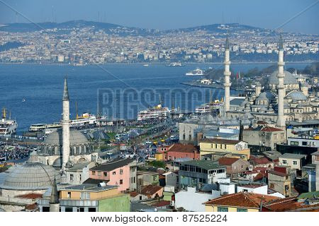 ISTANBUL, TURKEY - MARCH 23, 2014: Aerial view to Bosporus strait and Yeni Mosque. Built in 1665, the mosque is situated on the Golden Horn and is one of the famous architectural landmarks of Istanbul