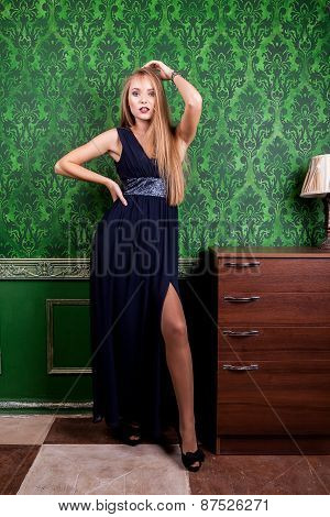 Gorgeous Woman With Long Dress In Vintage Green Interior