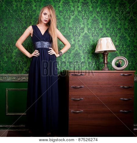 Gorgeous Woman In Long Blue Dress On Green Vintage Background