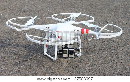PILSEN CZECH REPUBLIC - MARCH 17, 2015: Drone quadrocopter Dji Phantom 2 with digital camera GoPro HERO4 Black edition. New tool for aerial photo and video.