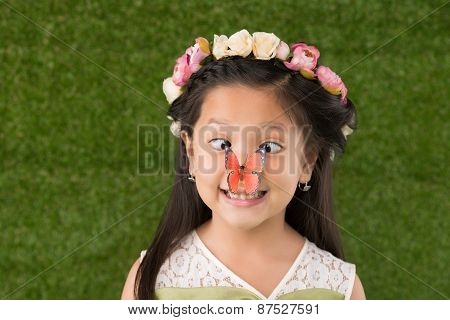 Funny girl with butterfly on nose
