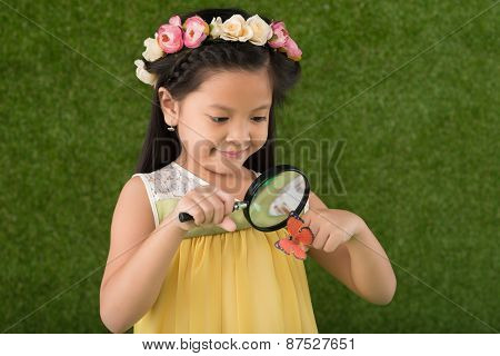Girl with magnifying glass