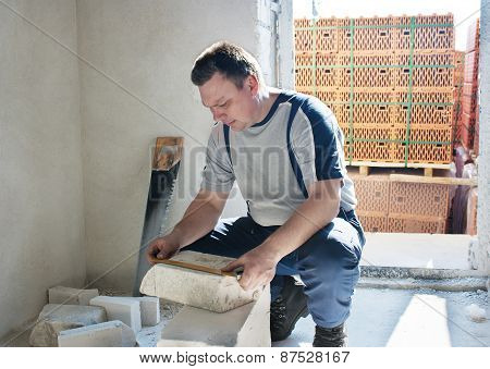 Man Worker Measures The Ruler Silicate Brick