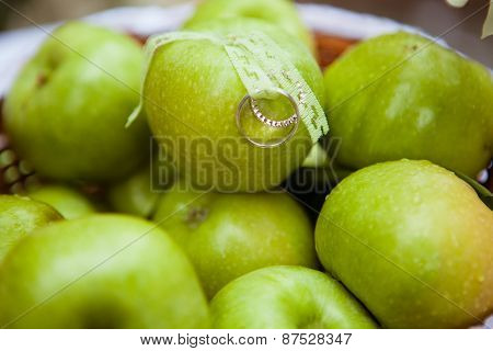 Wedding Rings On The Green Apples
