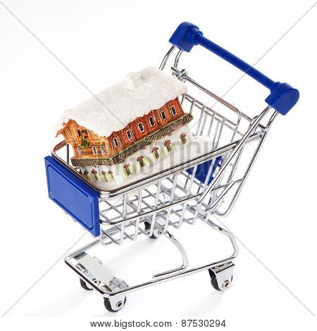 Shopping Trolley With House Isolated