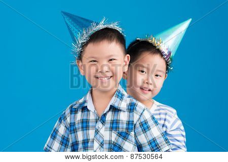 Children in party hats