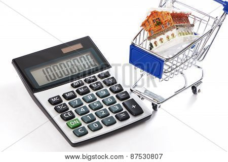 Calculator, Shopping Trolley And House Isolated