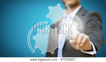 Businessman With Gears And Cogwheels