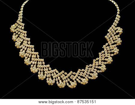 Gold and diamond necklaces isolated on black background.