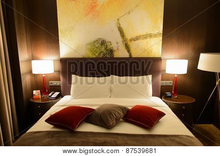 MOSCOW, RUSSIA - MARCH 29, 2015: Hilton bedroom interior. Hilton Hotels & Resorts  is an international chain of full service hotels and resorts and the flagship brand of Hilton Worldwide