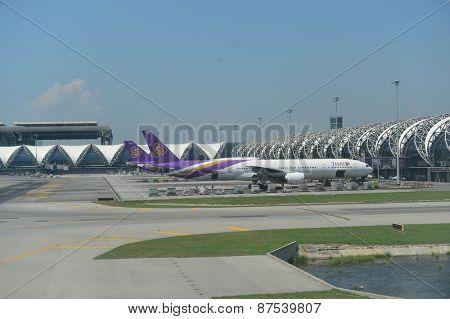 BANGKOK, THAILAND - MARCH 31, 2015: docked flights in Bangkok Suvarnabhumi Airport. Suvarnabhumi Airport is one of two international airports serving Bangkok, Thailand.
