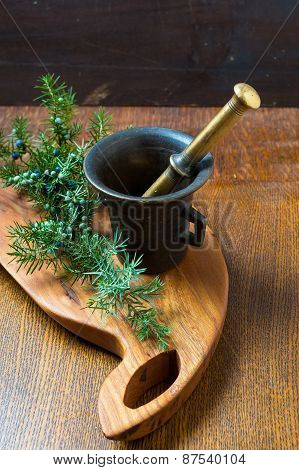 Mortar With Juniper Berries. Preparation Of Spice