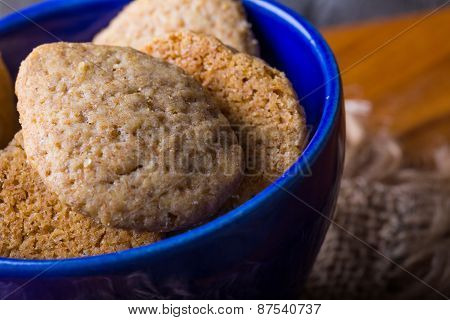 Homemade Spelled Cookies In Blue Bowl On Wooden Table