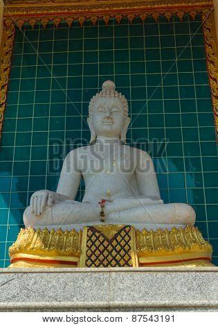 White sitting buddha stone carving