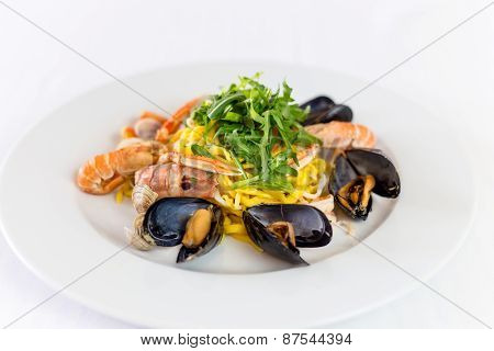 Noodles With Mussels And Shrimp On White Dish Background