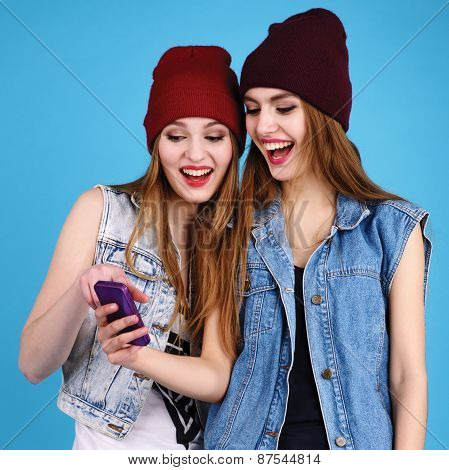 Two Young Beautiful Girls Read Messages On Your Mobile Phone