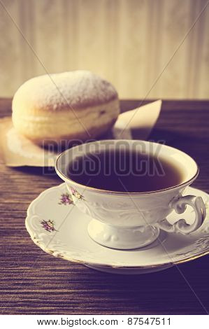 Doughnut With Cup Of Coffee In Old-fashioned Room
