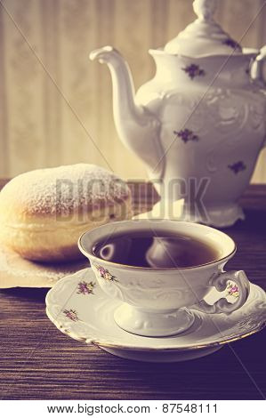 Doughnut With Cup Of Tea On Table In Old-fashioned