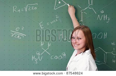 Female College Student Presents In A Laboratory