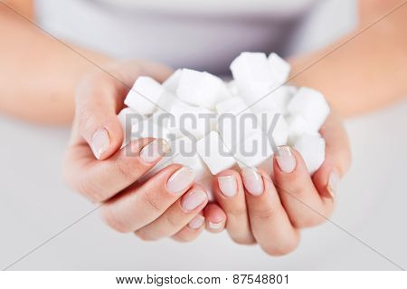 Woman Holds In Hands Of Sugar Cubes