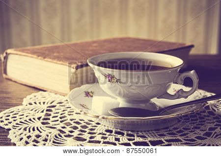 Cup Of Tea With Book On Napkin Vintage Effect