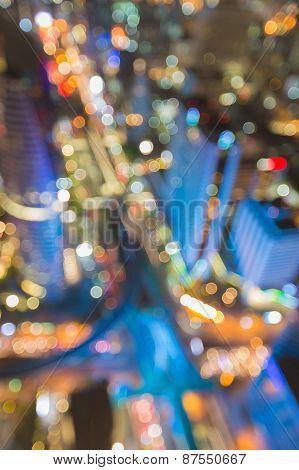 Blurred city at dusk. defocused concept of Bangkok main traffic