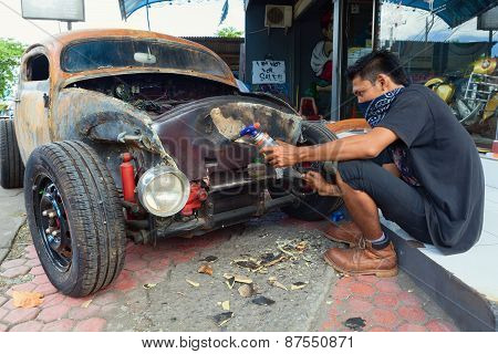 Young Balinese Man Renews Old Car