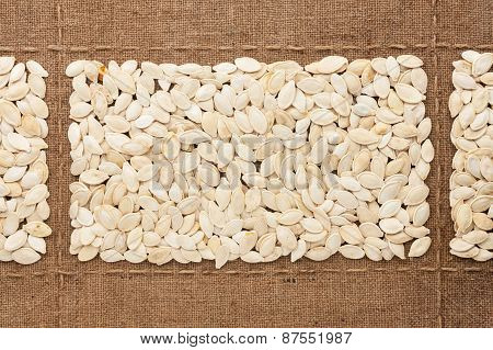Pumpkin Seeds On Sackcloth, With Place For Your Text