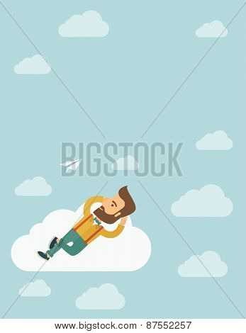 A hipster Caucasian man is relaxing while lying on a cloud